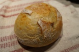 A finished boule with a shiny crunchy crust